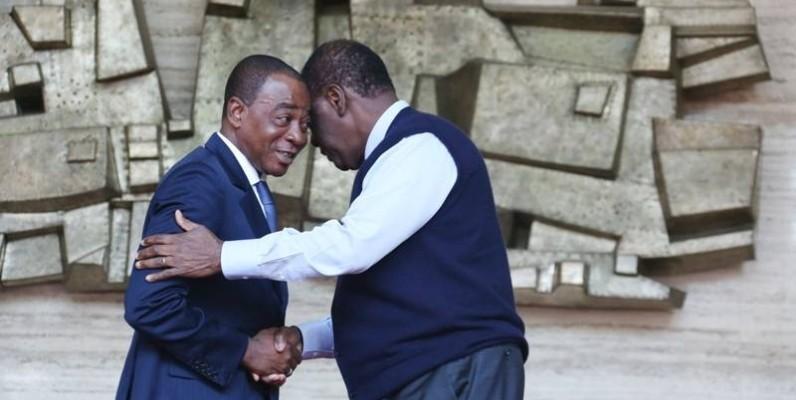 Le Chef de l'Etat, Alassane Ouattara (à droite) en compagnie de Charles Diby Koffi (DR)