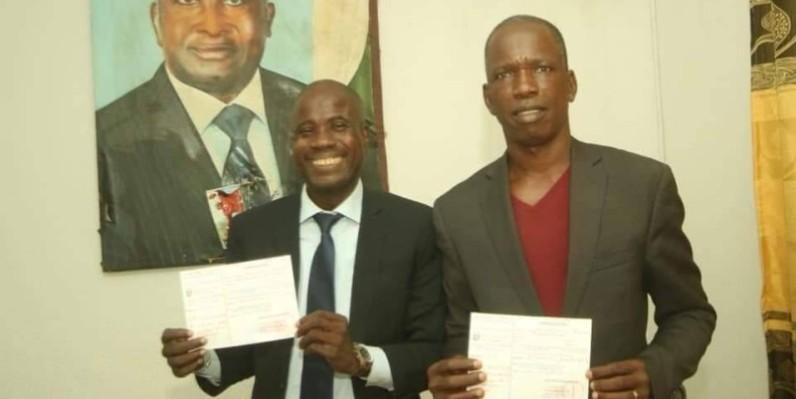 Yacouba Gbané (à gauche) Directeur de publication du quotidien « Le Temps » et son collaborateur, Barthélemy Téhin(à droite) .