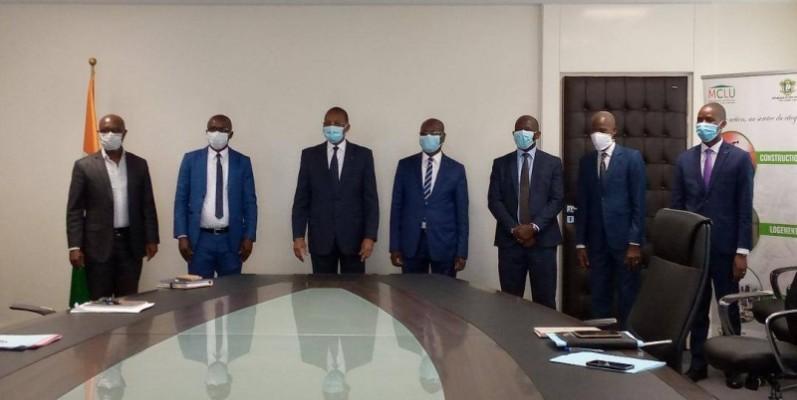 Avec l'appui du ministre de la Construction, du Logement et de l'Urbanisme; Bruno Koné, Boko Michaël, Pca du (Mupemenet-ci), s'engage à démarrer les travaux.(DR)