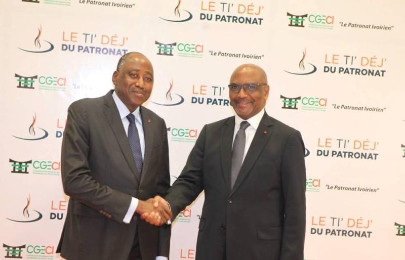 L'ex-premier ministre Amadou Gon Coulibaly et le Président de la CGECI, Jean-Marie ACKAH