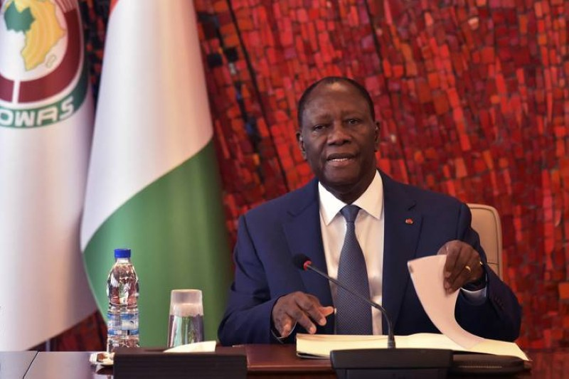 Ivorian President Alassane Ouattara attends a meeting of the National Security Council at the Presidential Palace in Abidjan following the outbreak of the COVID-19 (new Coronavirus) on March 16, 2020. - Ivory Coast closed on march 16 its borders to all non-Ivorian citizens as well as its schools and universities. (Photo by SIA KAMBOU / AFP)