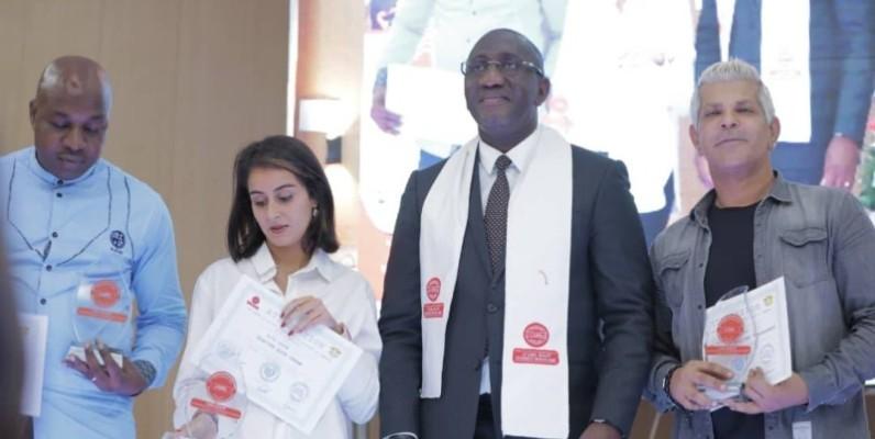 Le ministre du Commerce et de l'Industrie, Souleymane Diarrassouba, parrain de l'édition, a remis les trophées à plusieurs entreprises lauréates. (DR)