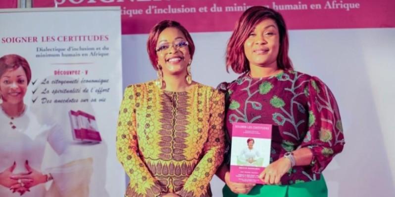 Reckya Madougou (à gauche) en compagnie de la secrétaire d'État Myss Belmonde Dogo, à l'occasion de la dédicace de son ouvrage. (DR)