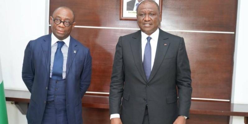 Le Premier ministre Hamed Bakayoko (à droite) en compagnie du président de la Boad, Serge Ekué. (DR)