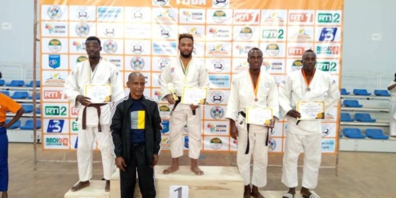Dadié Guillaule (au centre) a dominé la catégorie des -73kg. (DR)